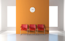 Three Red Chairs And Wall Cloc...
