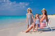 Young mother and her little girls enjoy summer vacation