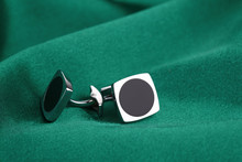 Pair Of Cuff Links On Green Si...