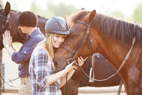 Fotografija Woman hugging horse and expressing joy and heppines