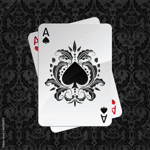 Photo  two aces playing cards on black damask pattern(spades)