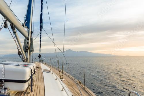 Sailing boat under power in calm seas