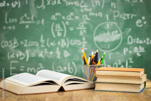 School books on desk Poster