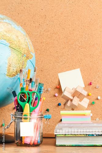 Fotografie, Obraz  School accessories on desktop with blank pinboard in the backgro