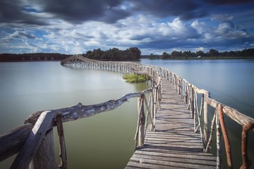 Fototapeta Mosty Wooden bridge crossover reservoir southern of Thailand