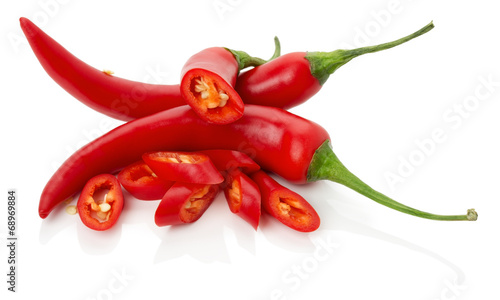 Staande foto Hot chili peppers red chilly peppers with slices isolated on the white background