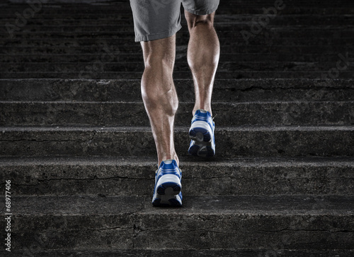 Fotomural Close up of young man running up the stairs