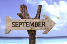 September Sign With A Beach On Background