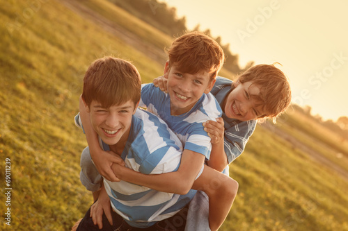 Portrait of three happy cheerful brothers Canvas Print
