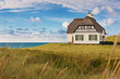 Leinwandbild Motiv Haus am Meer
