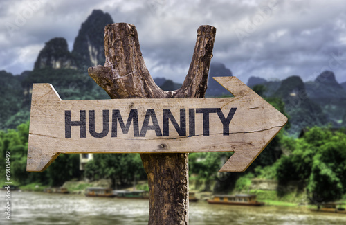 Fotografie, Tablou Humanity wooden sign with a forest background