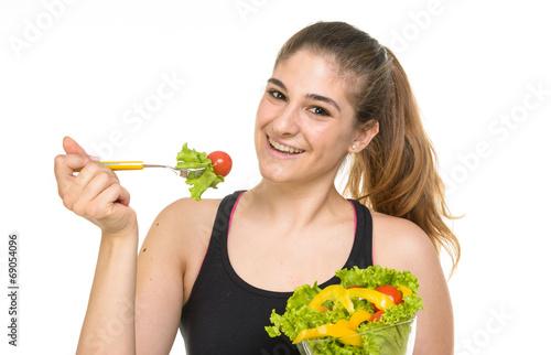 Fotografie, Obraz  Ragazza felice di mangiare un'insalata