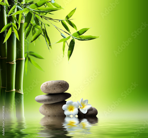 Akustikstoff - spa background with bamboo and stones on water