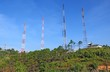 Telecommunications tower on mountain with blue sky