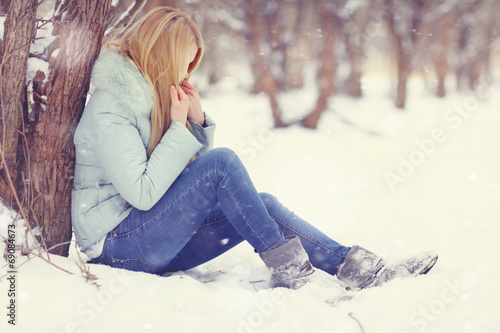 Vászonkép sad girl frozen, winter, cold, stress, park