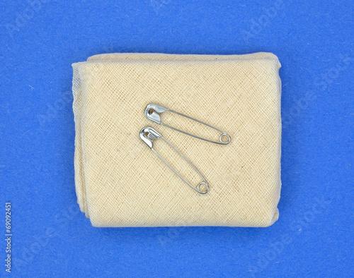 Fotografie, Obraz  Triangular muslin bandage with fasteners