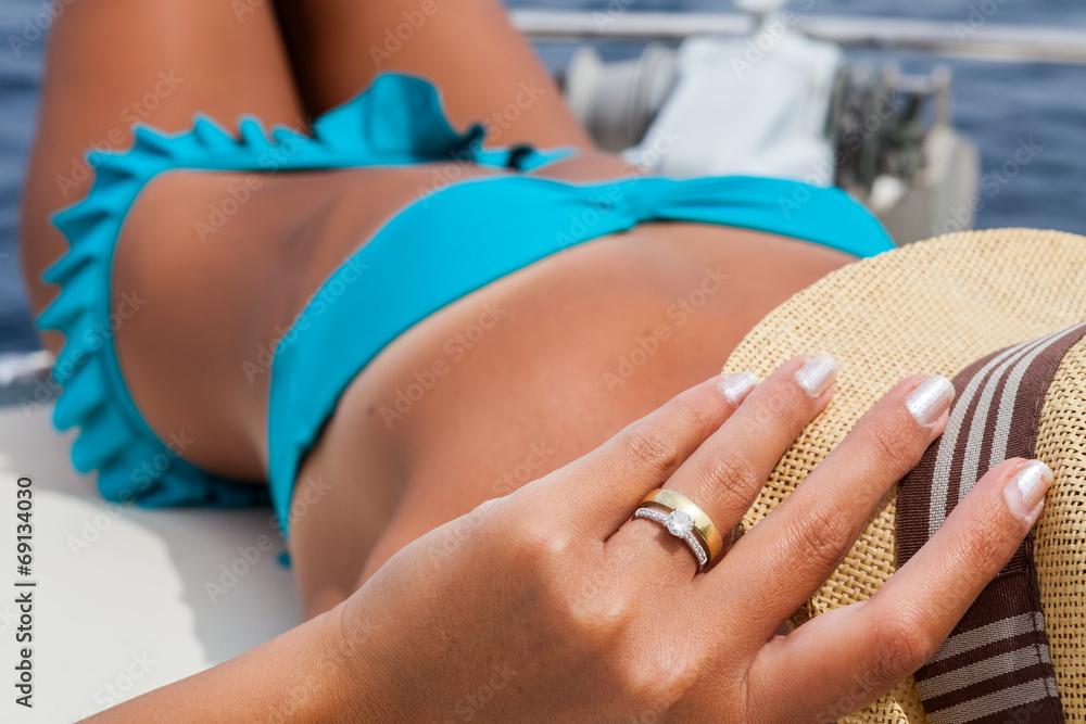 Fototapety, obrazy: Attractive girl sunbathing on a yacht