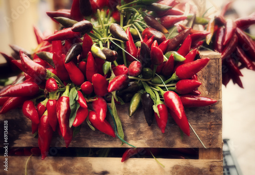 Tuinposter Hot chili peppers bunch of red hot chili pepper at market