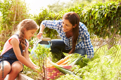 Mother And Daughter Working On Allotment Together Wallpaper Mural