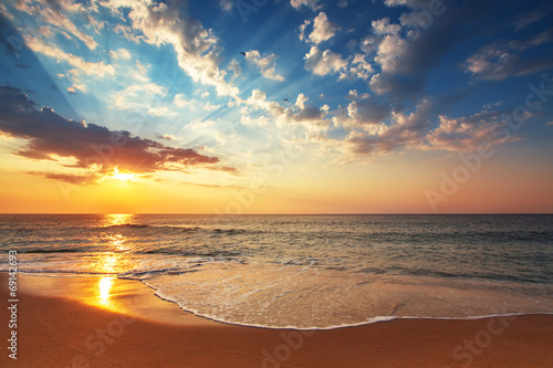 Foto op Canvas Oranje Beautiful cloudscape over the sea, subeam