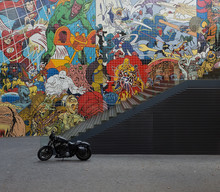 Motorcycle Standing At Ladder And Wall With Graffiti In Lisbon