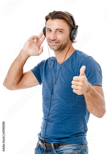 Fotografie, Obraz  Young man listening to music