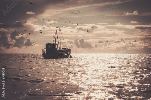 Staande foto Schip Fisherman's boat in a sea