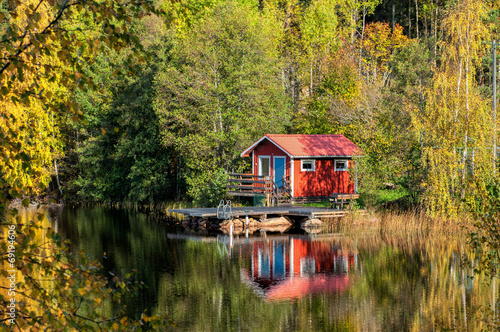 Photo  Traditional Swedish summer cottage during autumn