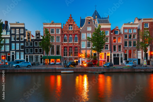 Poster Amsterdam Night city view of Amsterdam canal with dutch houses