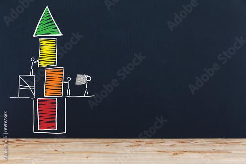 Fotografie, Obraz  Stichmännchen bauen Turm auf einer Tafel