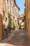 Fototapeta Uliczki - Sunny streets of Italian city Pienza in Tuscany