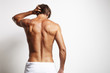 canvas print picture - perfect fit man from the back in white towel