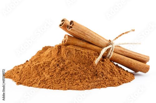Canvas Print Cinnamon powder and sticks