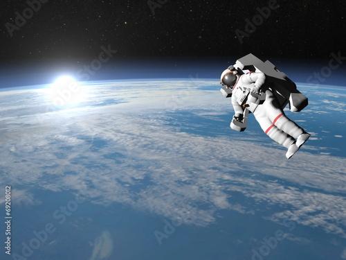 Fotografie, Obraz  Astronaut or cosmonaut flying upon earth - 3D render