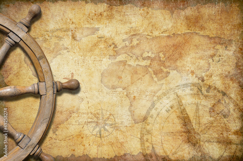 aged treasure map with steering wheel