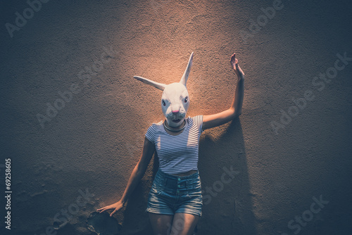 young hipster woman with rabbit mask Canvas Print