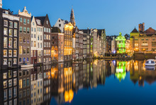 The Damrak Canal In Amsterdam, Netherlands.