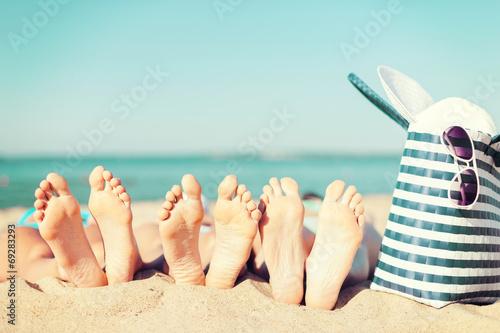 Fotografia  three women lying on the beach