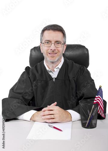 Fotografija  middle aged caucasian american judge in a robe sitting