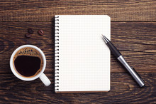 Cup Of Coffee And Notepad