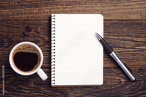 Cup of coffee and notepad Wallpaper Mural
