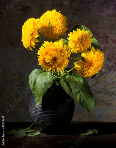 Still life with beautiful sunflowers in vase