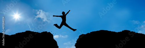 Fotografie, Obraz  jumping over a precipice between 2 mountains - 3 to 1 - g1382