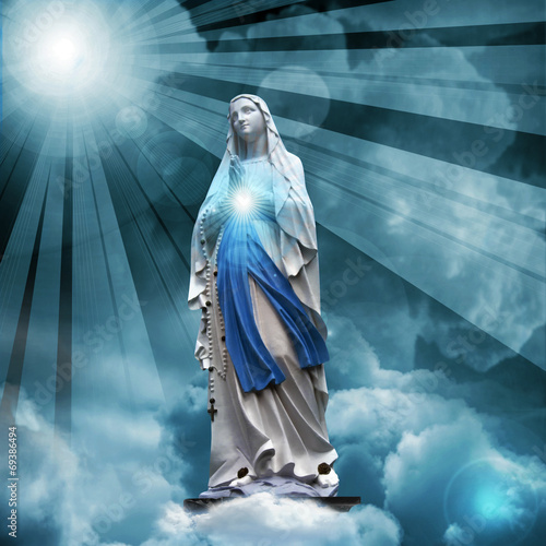 Fotografie, Obraz  Madonna statue with blue sky and clouds background