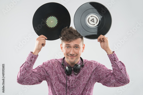 Photo  DJ having fun with vinyl record showing Mickey mouse ears