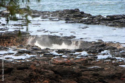 Fotografie, Obraz  Water Shooting Upward From Spouting Horn Blowhole Kauai Hawaii