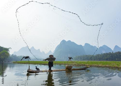 Cormorant, fish man and Li River scenery sight Canvas Print