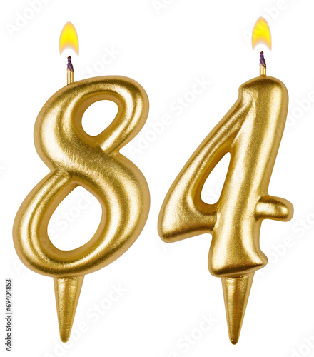 Photo  Birthday candles number eighty four isolated on white background