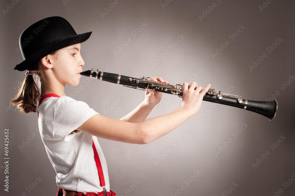 girl playing clarinet