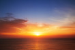canvas print picture - Beautiful cloudscape over the sea, sunset shot